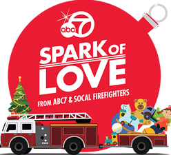 Spark of Love Logo with a Fire Truck and Toys