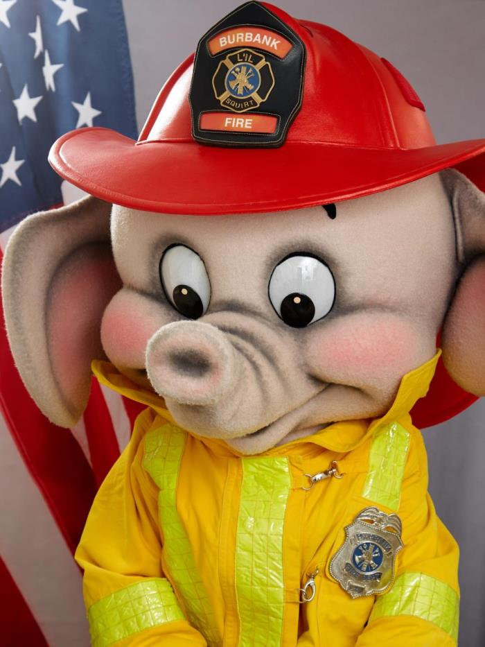Lil' Squirt, an elephant in firefighter gear
